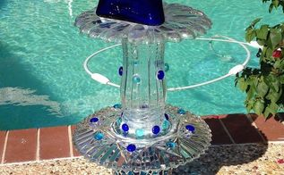 finally started making my plate flowers and glass towers what fun, crafts, repurposing upcycling, My 1st glass totem I used GE Silicone but found out it does NOT dry clear so I switched to Plumbers GOOP and is clear water proof and strong Top piece looks off center but it s a triangle cobalt bottle looks straight from the front