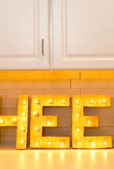 make your own diy vintage marquee for the holidays, lighting, seasonal holiday decor, Materials needed 12 inch paper mache letters globe string lights about 10 lights per letter spray paint