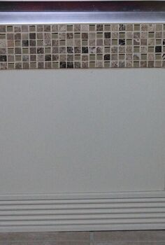 design solution for ugly tub front, bathroom ideas, diy, home decor, tiling, After Photo The visual created by the panel was a great improvement over the glaring white space created by the whirlpool tub front