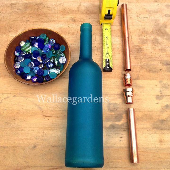 Wine bottle watering device with copper tubing for container gardens hometalk - Empty colored wine bottles ...