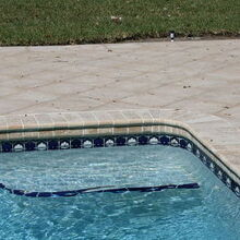 renovating a pool deck without removing old cracked concrete deck, concrete masonry, decks, outdoor living, pool designs, After The result is perfect and it saves time and money as you don t need to remove the old concrete slab The pavers are installed over the deck laid down over sand with no grout That will allow the pavers adjust to natural terrain shifting