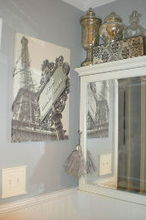 teeny tiny master bath renovation, bathroom ideas, home decor, painting, woodworking projects, The Eiffel Tower photo was my inspiration for the color scheme of the room The medicine cabinet was 7 00 at a yard sale