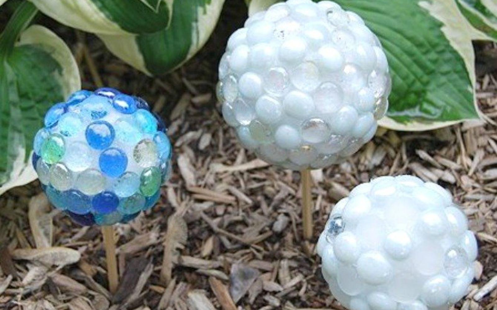 s 17 stunning ideas for your dollar store gems, crafts, gardening, Create garden gazing stones