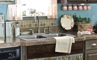 vintage farm kitchen, home decor, kitchen design, painted furniture, Painted and distressed grey lower cabinets stained walnut upper and black upper cabinets Repurposed wood trim used to give the impression of a farmhouse sink