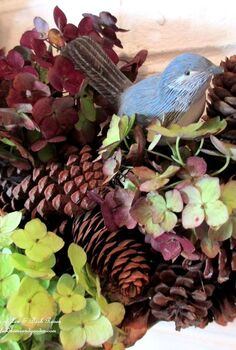 fall decorating dried hydrangeas, crafts, seasonal holiday decor, wreaths, Dried hydrangea blossoms from my garden accent our pinecone wreath for Fall for free Another of my Use What You Have projects See more at
