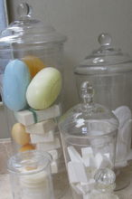 organizing tips for the bathroom, bathroom ideas, organizing, Metropolitan Organizing NC Squeaky clean glass apothecary jars are one way to categorize and display soaps cotton pads makeup wedges Q tips and other bathroom essentials