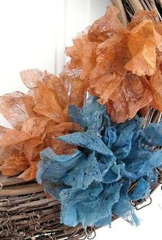 dryer sheet flowers tutorial, crafts, doors, wreaths, I added my dryer sheet flowers to a plain grapevine wreath that hangs on the inside of our front door Our accent color in our home is teal so this is a perfect merge of Fall colors