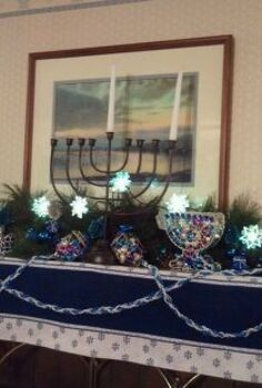 chanukah mantelpiece designs, christmas decorations, seasonal holiday d cor, The family room mantelpiece keeps the Channukah spirit going For parties we light the huge menorah and let the taper candles burn 8 hours