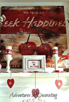 our 2013 valentine mantel, seasonal holiday d cor, valentines day ideas, Rather than create a garland I simply hung pink and red hearts that I also embellished with smaller decorative hearts at varying heights across the mantel