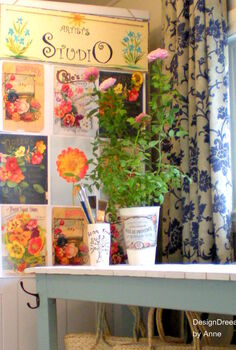 an indoor garden theme for the mudroom, home decor, laundry rooms, Vintage Seed Catalogue printouts are hung on the side of my dryer to disguise it Another vintage label is printed and glued to a galvanized can used as a planter