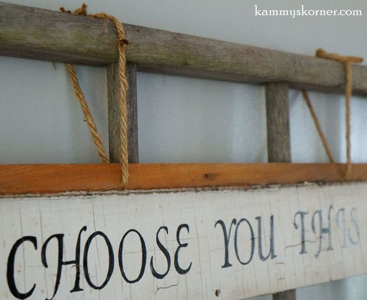 Striking Wall Decor Using Old Wood Siding And A Ladder