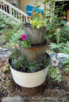 old buckets and flowers, flowers, gardening, repurposing upcycling, Old buckets and flowers hide an ugly stump
