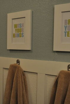 guest bathroom makeover, bathroom ideas, home decor, New board and batten on the walls towels on hooks and cute signs to add some fun to the space