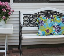 iron and wood bench make over who knew it looked so bad before, decks, outdoor furniture, outdoor living, painted furniture, After all the new flowers were potted we have a pretty spot to rest A friend pointed out I spelled Le fleurs incorrectly so I repainted the lettering on the bucket but didn t take more pictures I love spring time