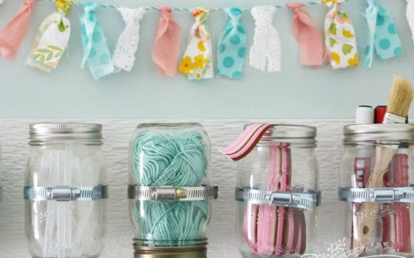 s 17 little known ways to use your wasted wall space, organizing, storage ideas, wall decor, Put pipe clamps and mason jars everywhere