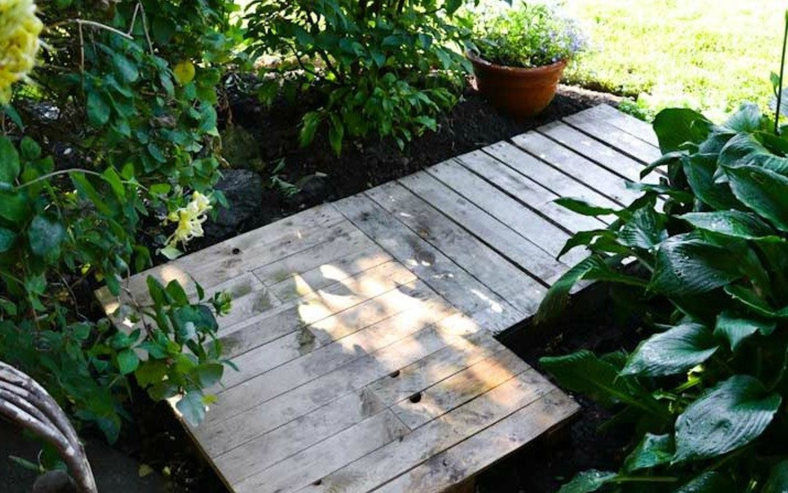 s 9 budget ways to make your walkway look even better than last year, concrete masonry, gardening, Use full pallets for an instant pathway