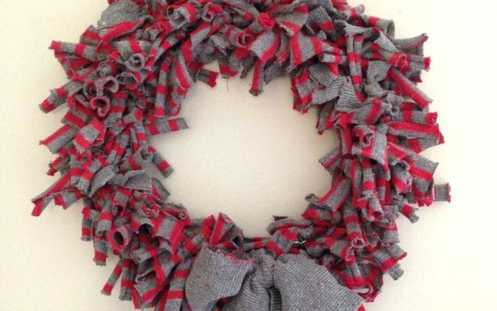s 15 reasons not to trash your ugly worn out sweaters, crafts, repurposing upcycling, Cut strips and make a rag wreath