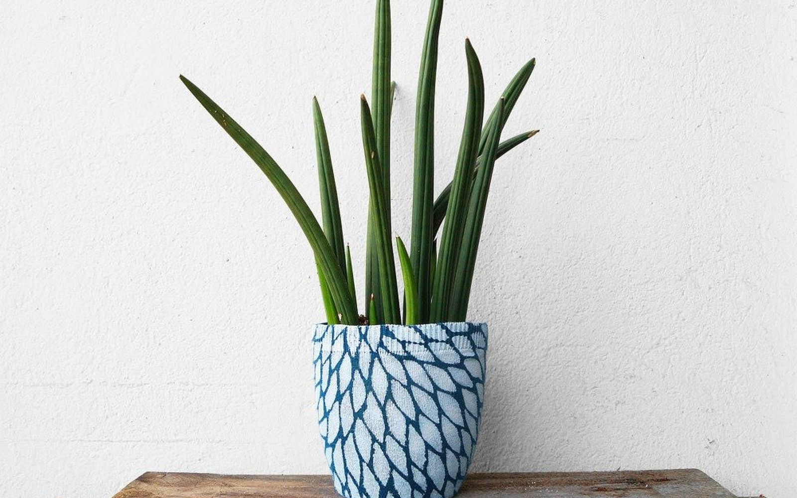 s 15 reasons not to trash your ugly worn out sweaters, crafts, repurposing upcycling, Make your spring flower pots look unique