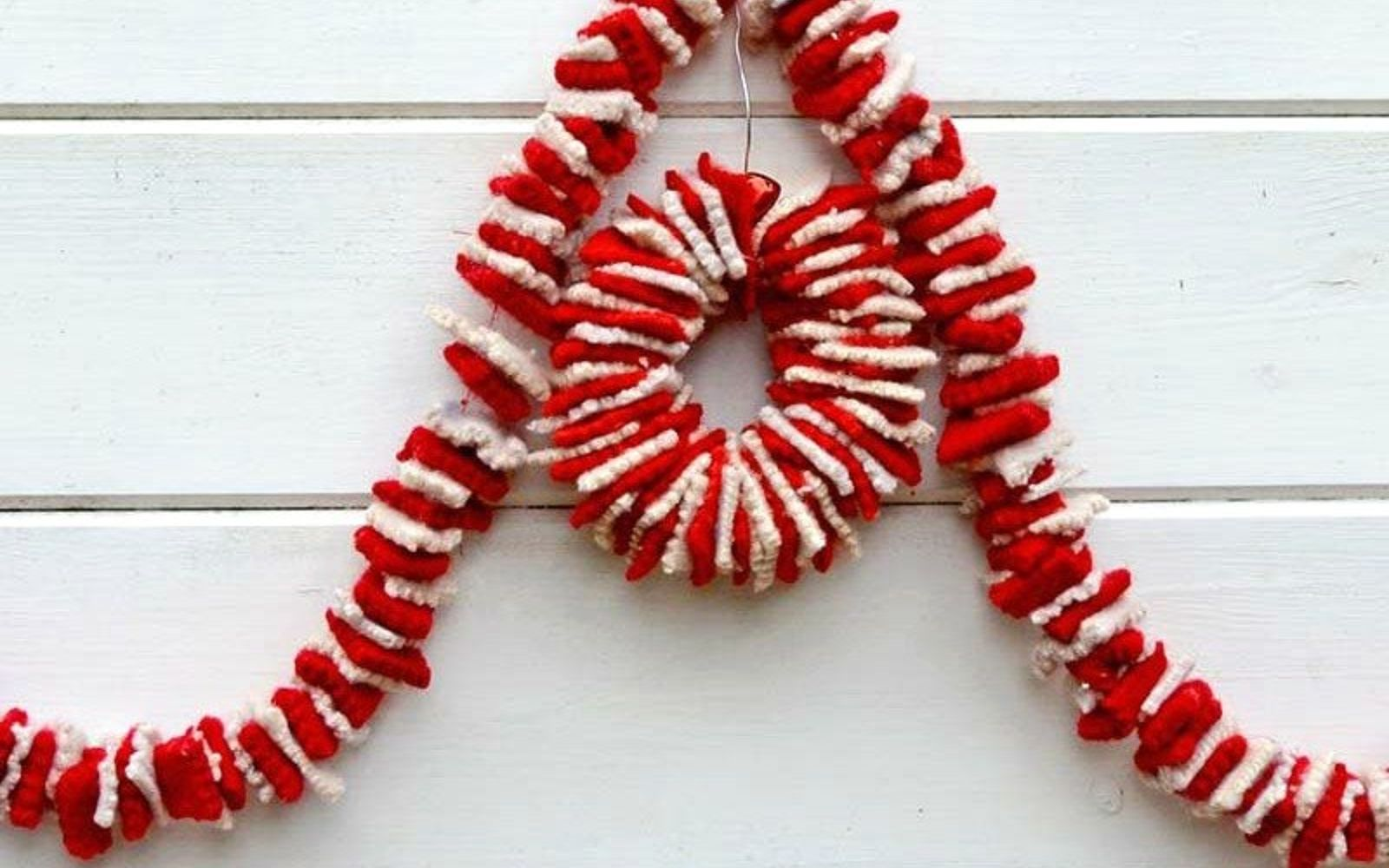 s 15 reasons not to trash your ugly worn out sweaters, crafts, repurposing upcycling, Cut up scraps and string them into a garland