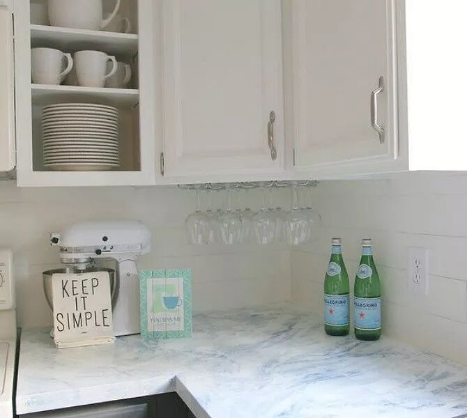 Make glossy marble veins with a spray bottle. 13 Ways to Transform Your Countertops without Replacing Them