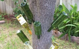 wine bottle garden decorations, outdoor living, repurposing upcycling