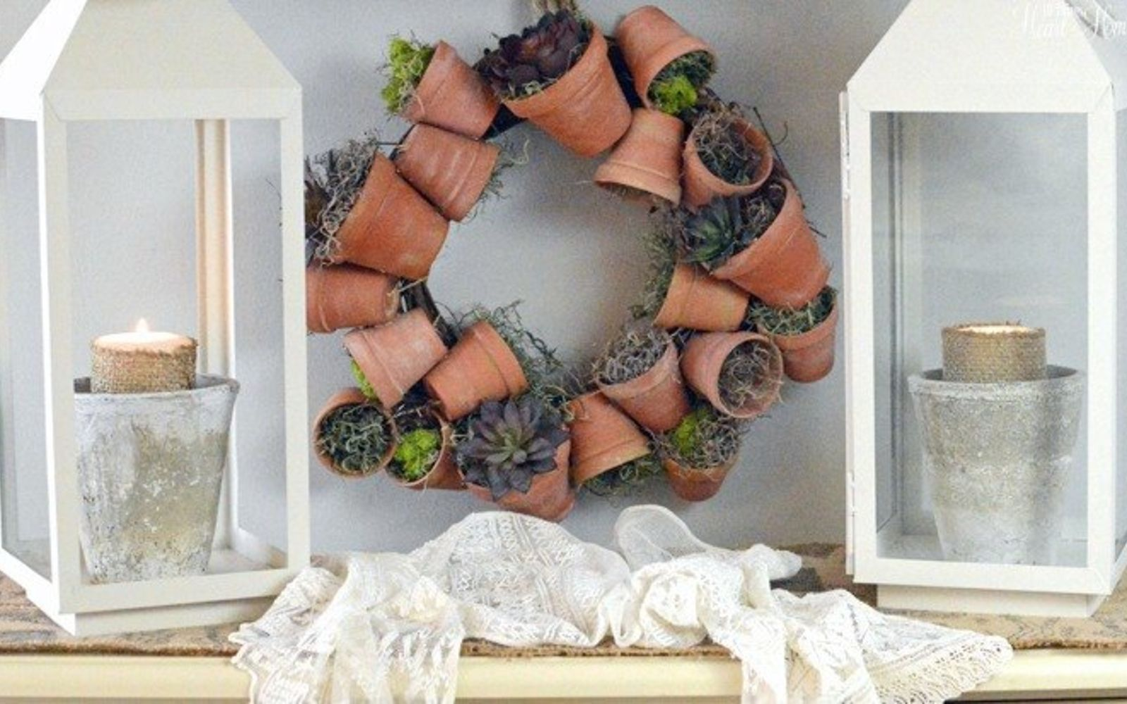 s 31 gorgeous spring wreaths that will make your neighbors smile, crafts, seasonal holiday decor, wreaths, String together live flower pots