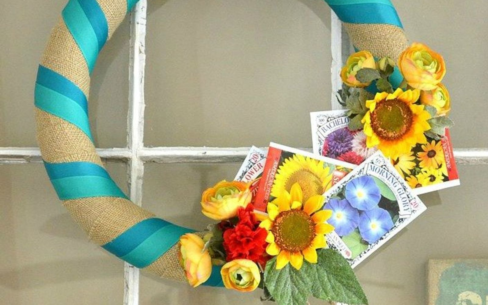 s 31 gorgeous spring wreaths that will make your neighbors smile, crafts, seasonal holiday decor, wreaths, Add some seed packets to a simple wreath