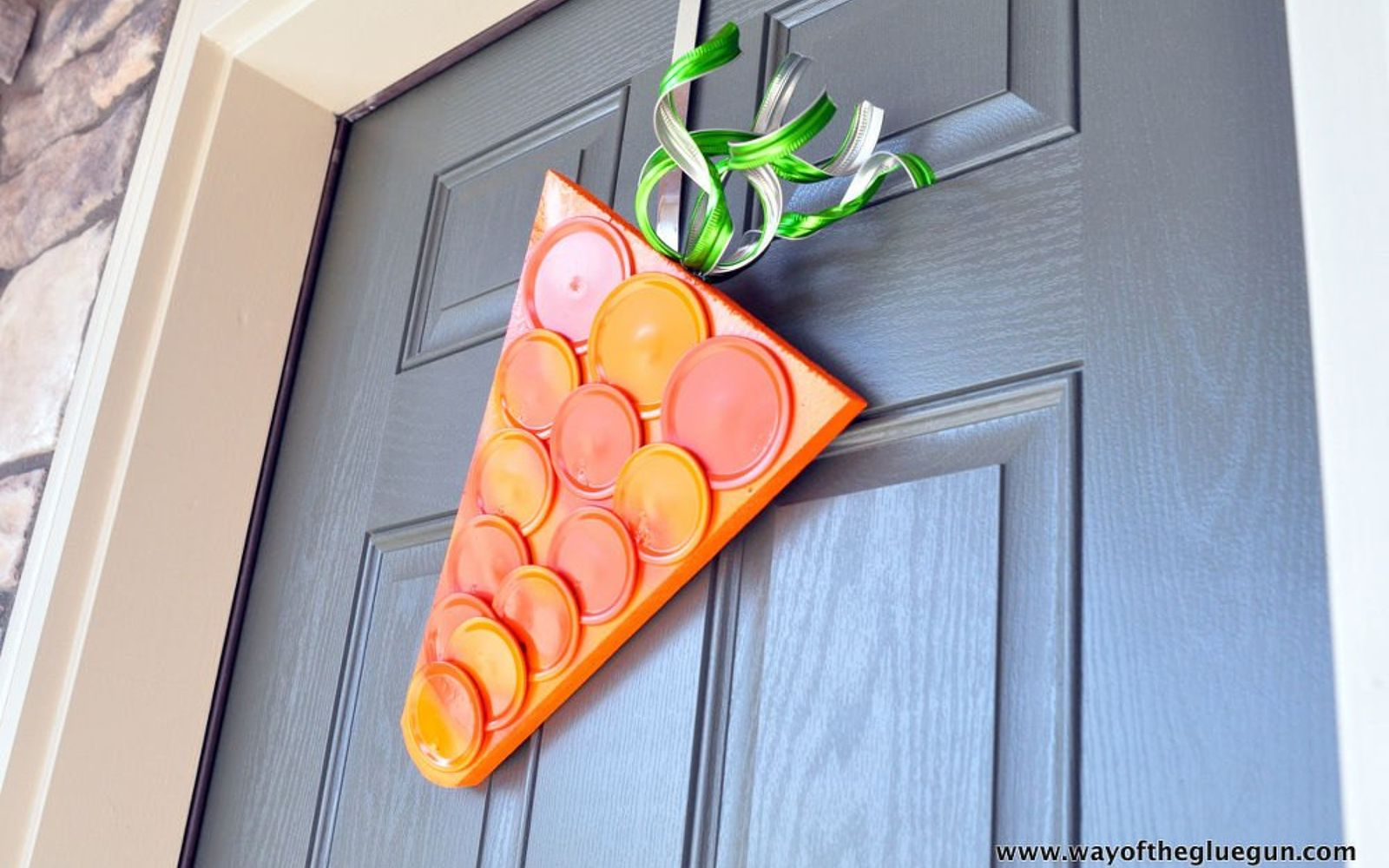 s 31 gorgeous spring wreaths that will make your neighbors smile, crafts, seasonal holiday decor, wreaths, Create a fun carrot hanger from canning lids
