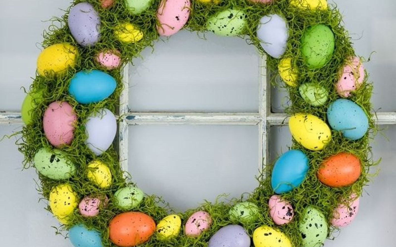 s 31 gorgeous spring wreaths that will make your neighbors smile, crafts, seasonal holiday decor, wreaths, Fill a wreath with colorful eggs