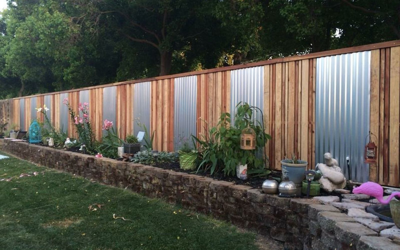 s 15 privacy fences that will turn your yard into a secluded oasis, curb appeal, fences, Accent an ordinary fence with sheet metal
