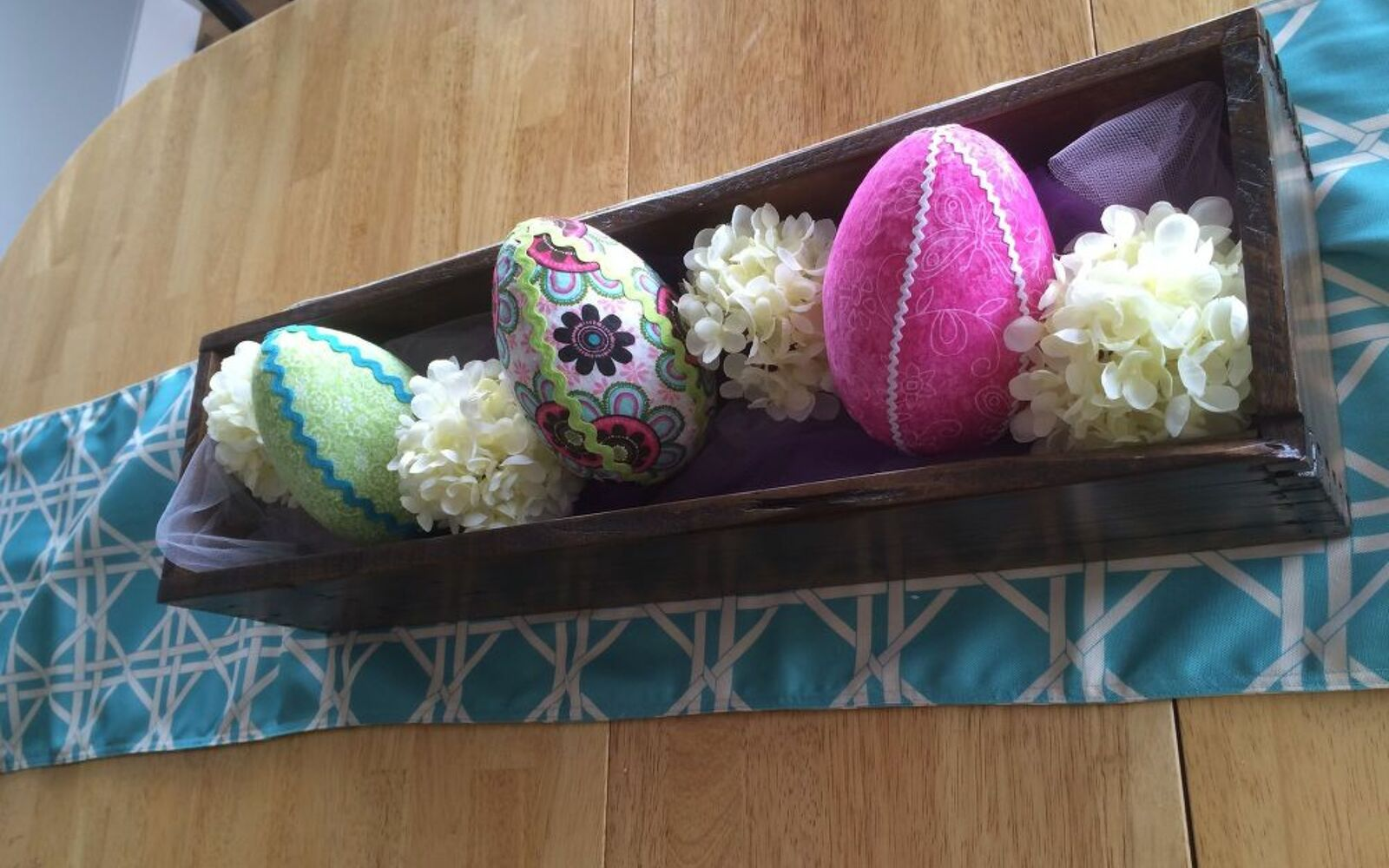 s 25 quick easter egg ideas that are just too stinkin cute, crafts, easter decorations, Use fabric scraps as colorful covers