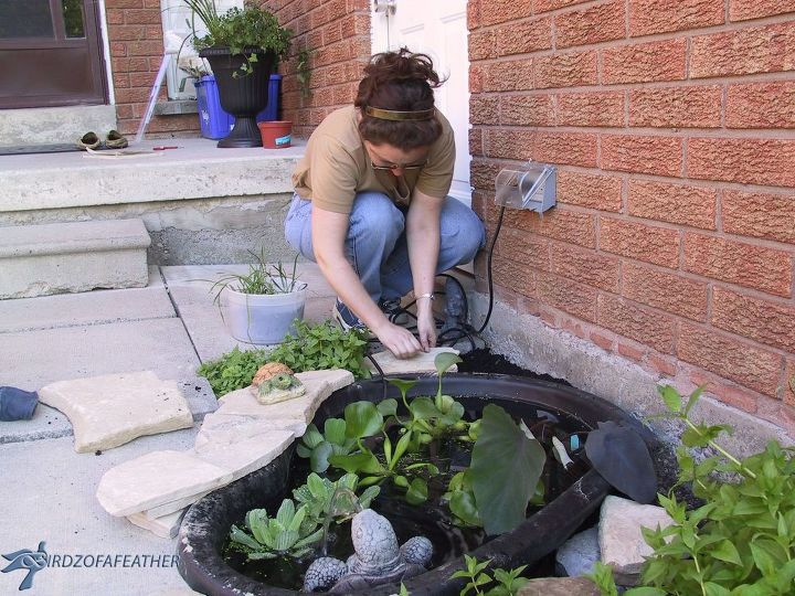 Create a small water feature and add curb appeal to your for Small pond water feature