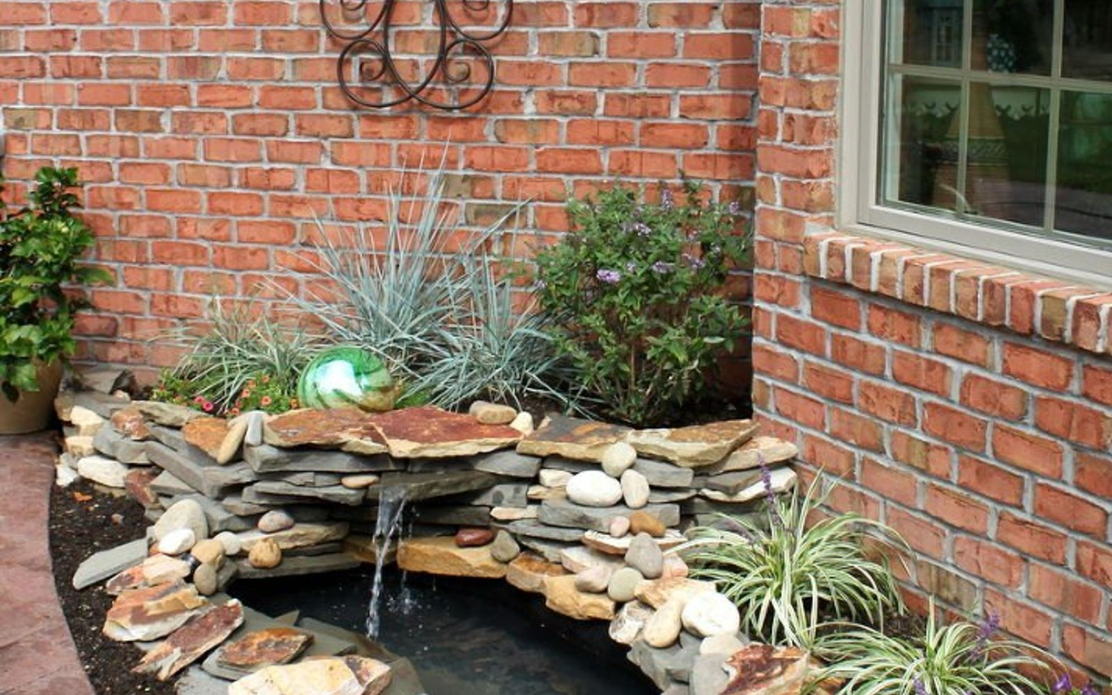 s 10 mini water features to add zen to your garden, outdoor living, ponds water features, Put a tiny waterfall pond beside your door
