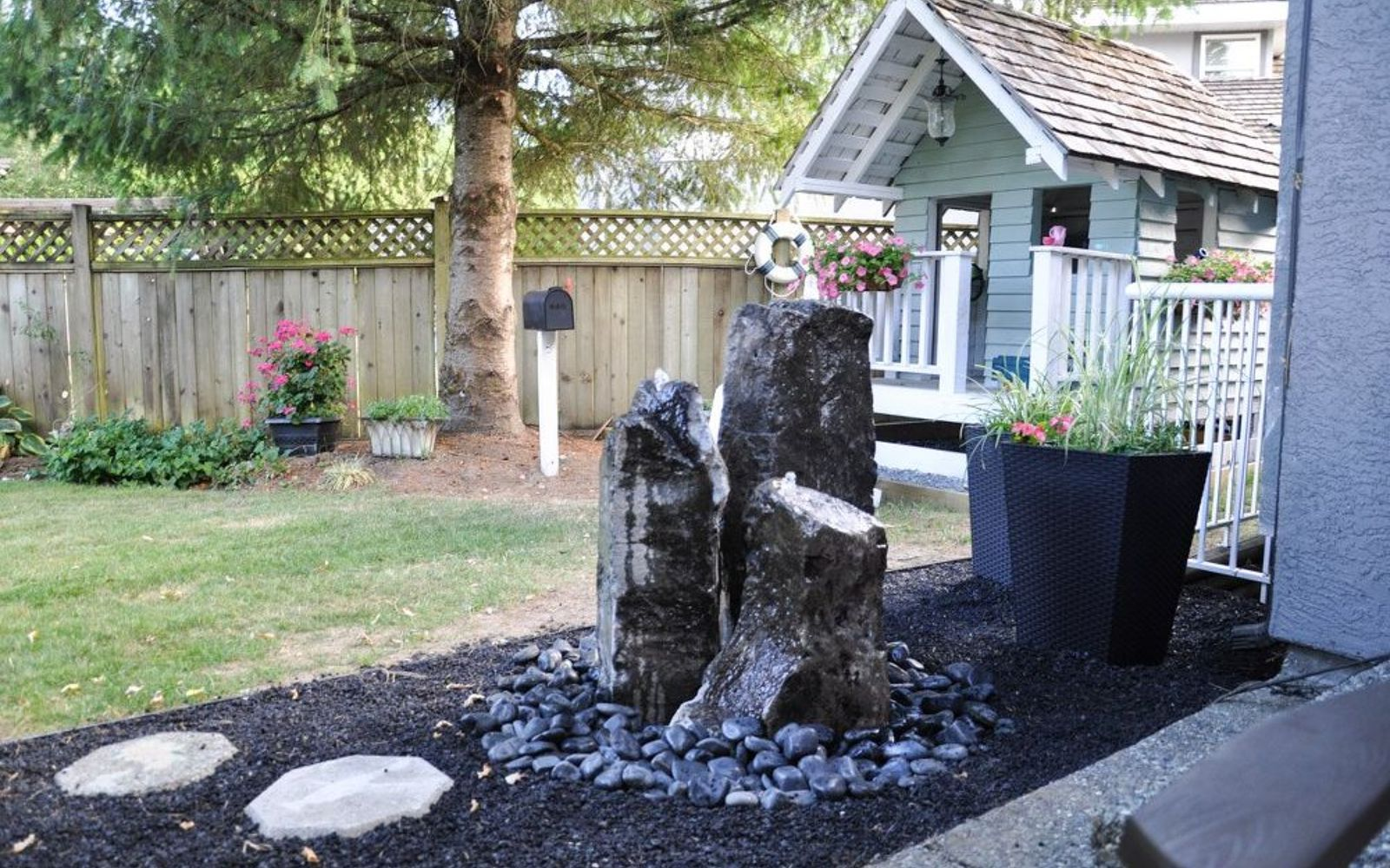 s 10 mini water features to add zen to your garden, outdoor living, ponds water features, Run a fountain through tall standing stones