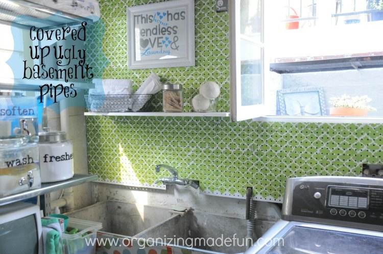 s 15 ways to organize every messy nook with pegboard, organizing, woodworking projects, Cover water pipes or just an ugly wall