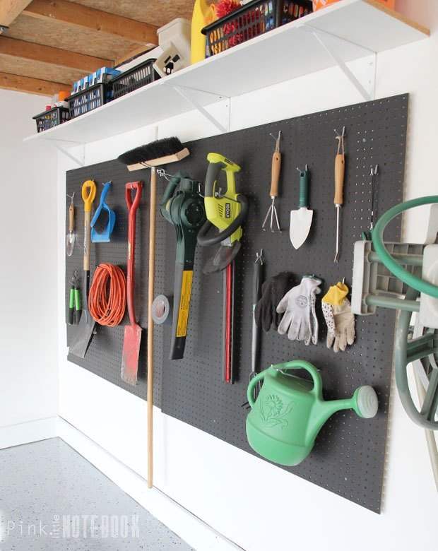 s 15 ways to organize every messy nook with pegboard, organizing, woodworking projects, Hang some on a garage wall for all your tools