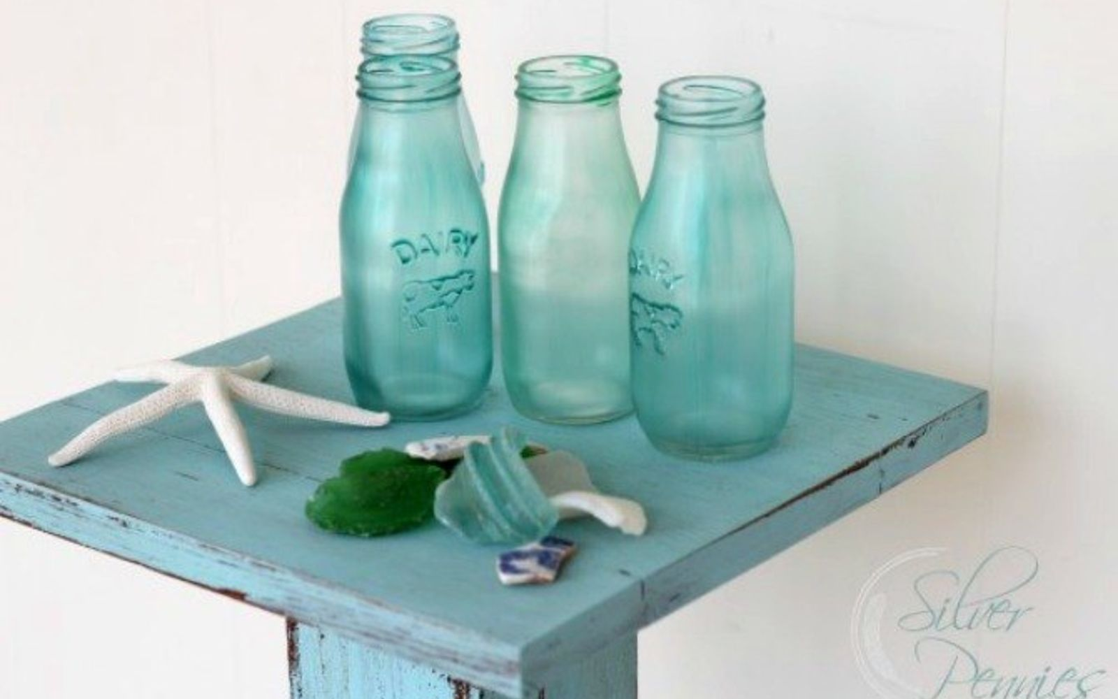 s 17 high end ways to use mod podge in your home, crafts, decoupage, home decor, Transform glass bottles into beachy treasure