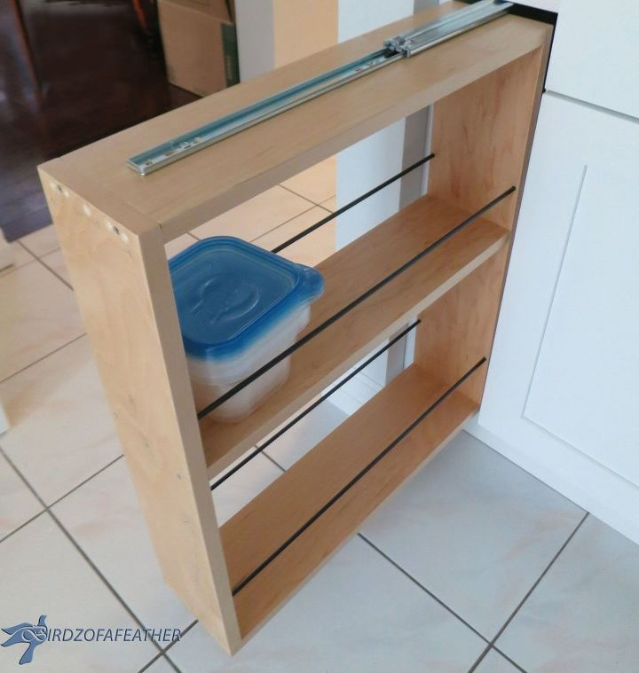 Hidden kitchen storage turn a filler panel into a pull for Best big box store kitchen cabinets
