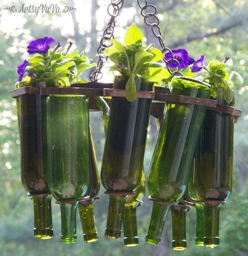 15 incredible backyard ideas using empty wine bottles for How to use wine bottles in the garden