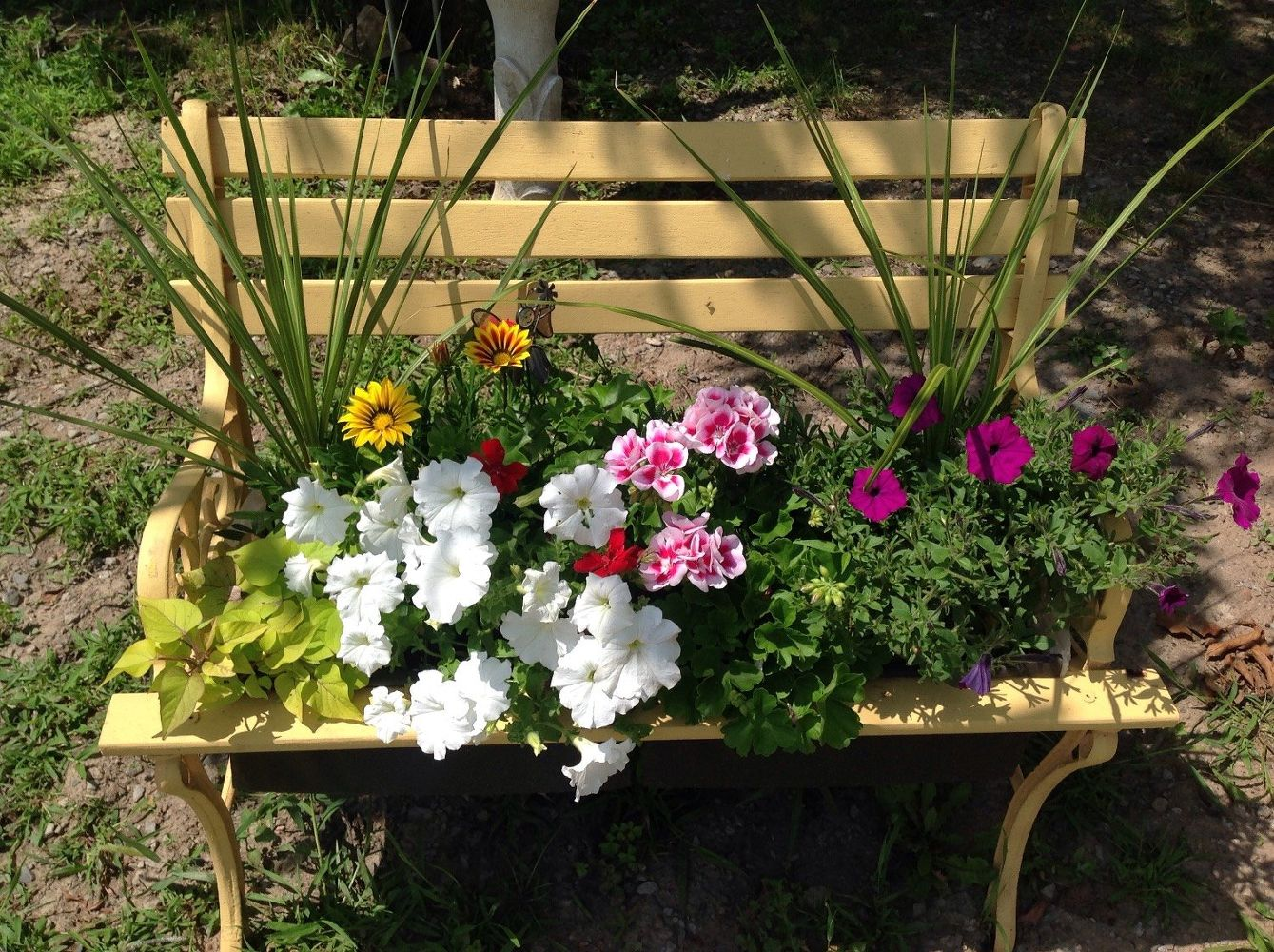 15 whimsical ways to use old furniture in your flower bed for Classic house with flower garden