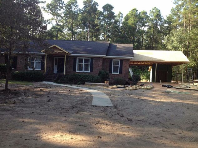 New carport and porch adds curb appeal to a 80 39 s brick for Brick carport designs