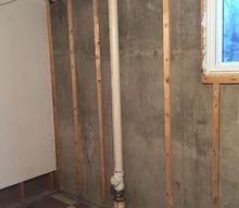 q how to hide a sewer line pipe , bathroom ideas, cosmetic changes, home improvement, Pipe in the future guest bedroom