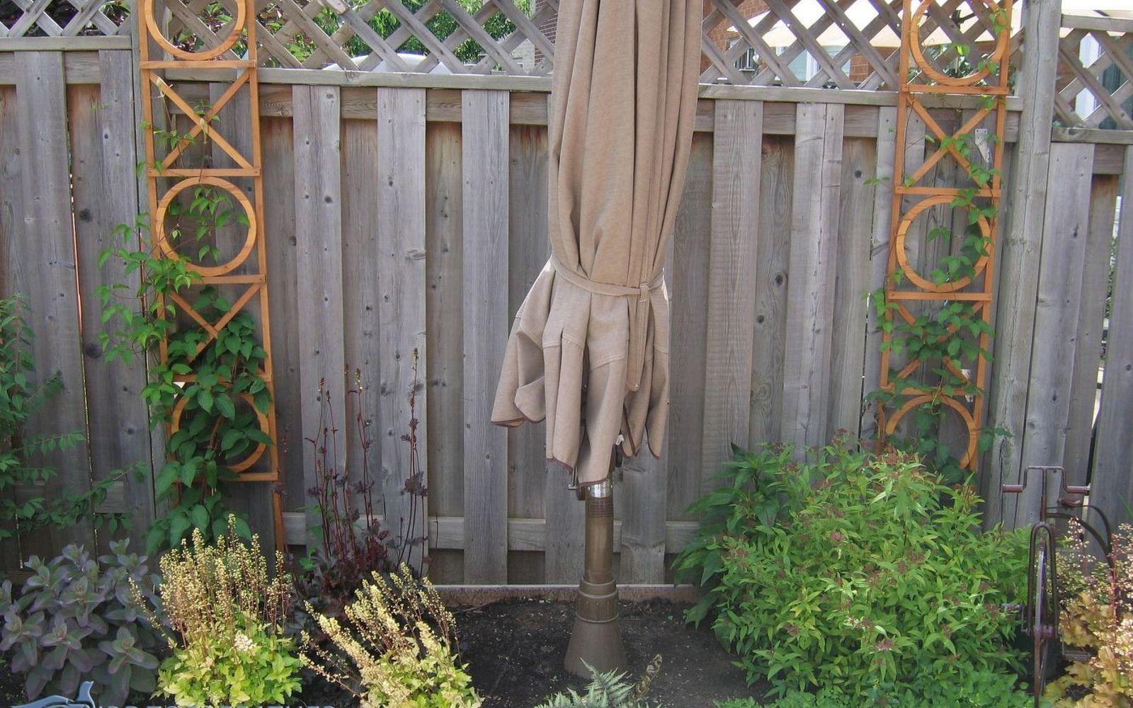 s 17 ways to build a gorgeous garden trellis this summer, gardening, Put wood beams by a boring garden walls