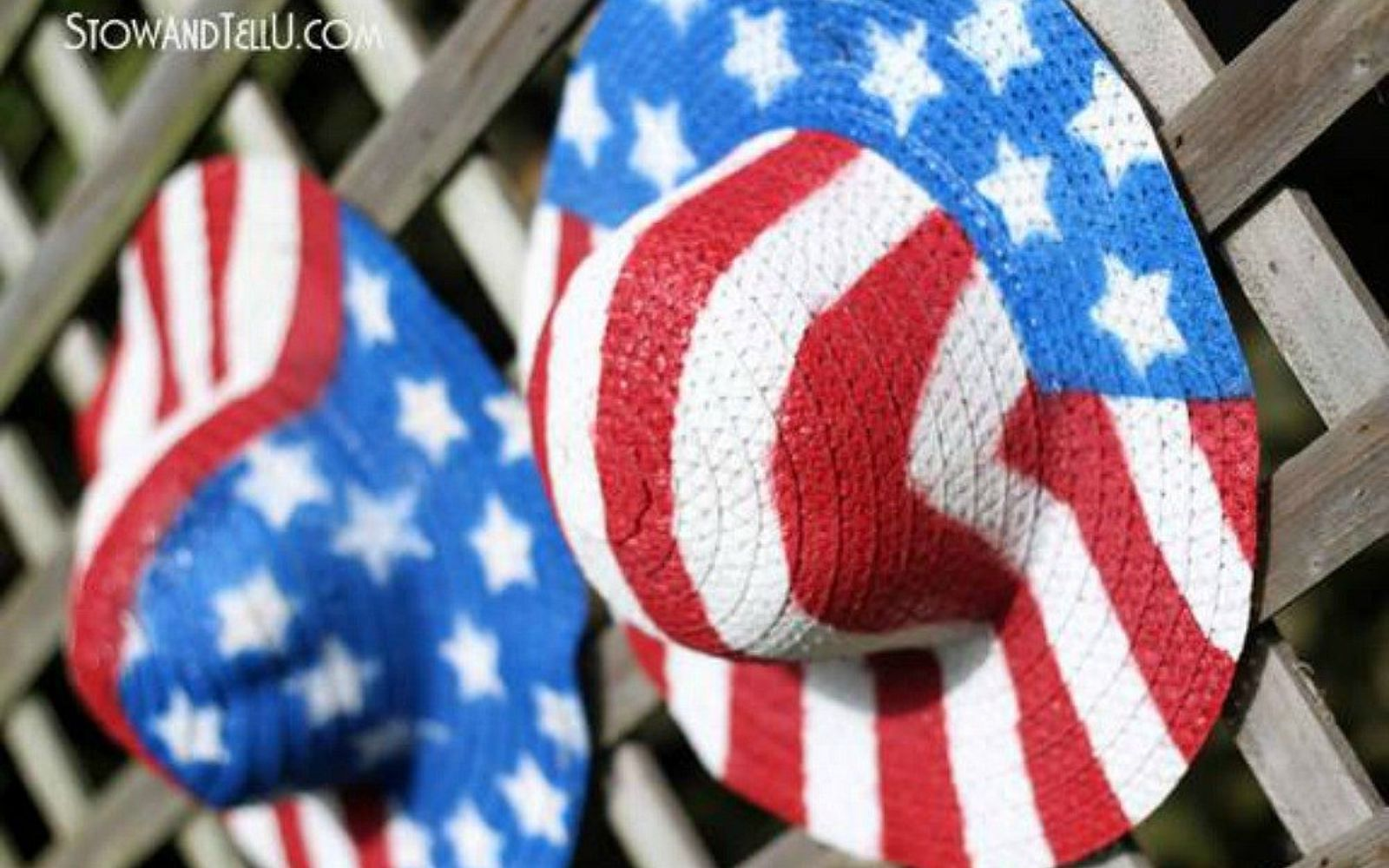 s 13 july 4th decorations that will blow your bbq guests away, crafts, outdoor living, seasonal holiday decor, Cover the fence with starred and striped hats