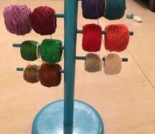 ikea hack paper towel holder turned into a crochet thread organizer, organizing