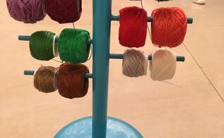 ikea hack paper towel holder turned into a crochet thread organizer, organizing