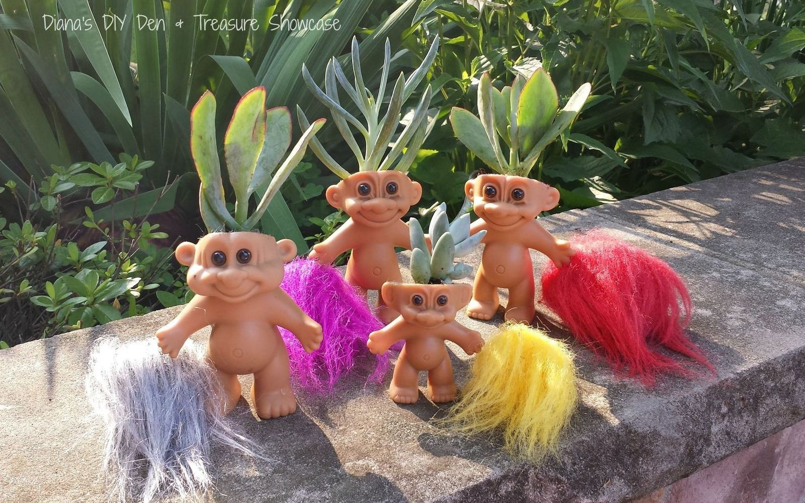 s 17 insanely fun ways to display your favorite succulents, flowers, gardening, succulents, Plant them in a group of troll dolls