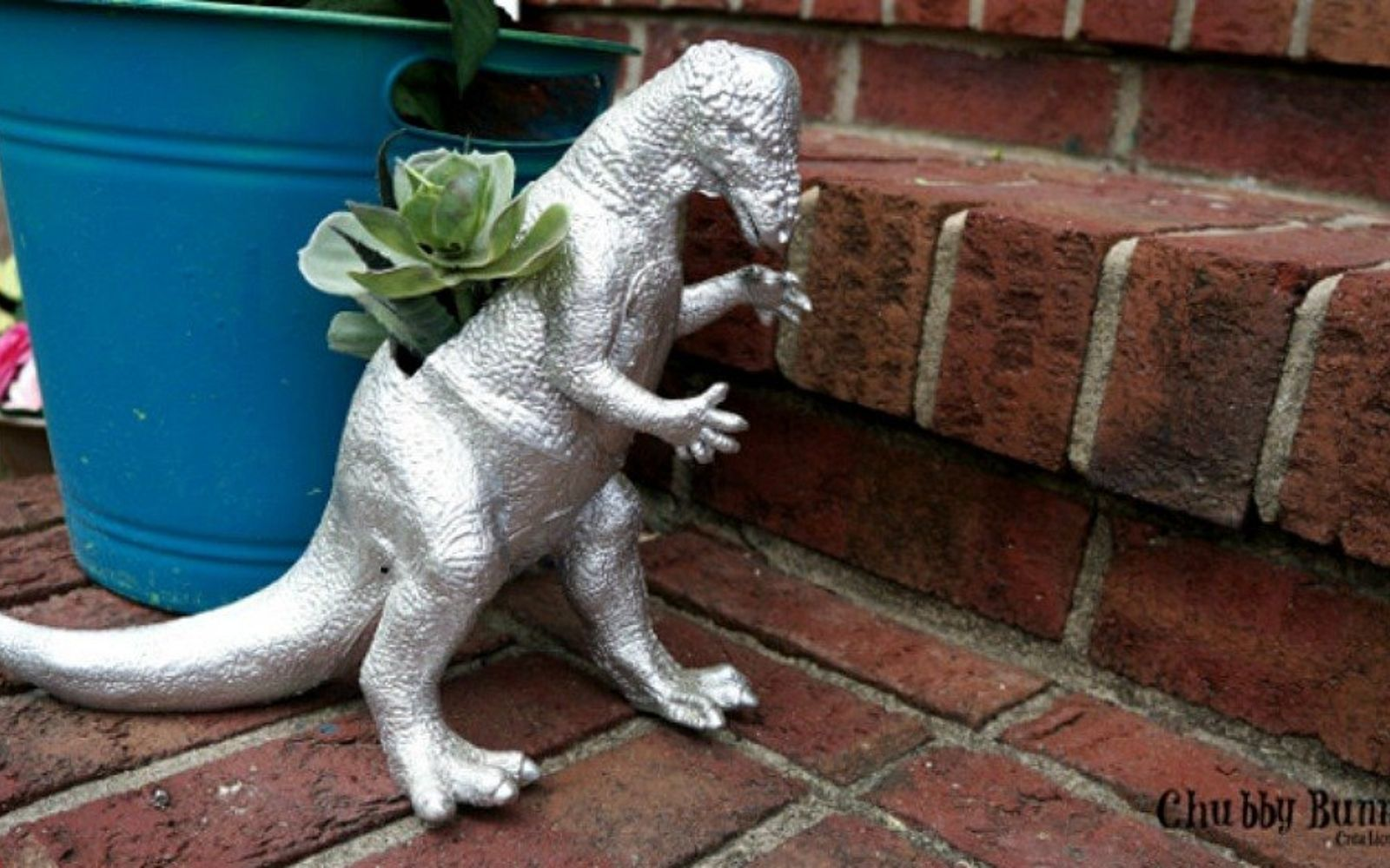 s 17 insanely fun ways to display your favorite succulents, flowers, gardening, succulents, Turn a dinosaur toy into a planter