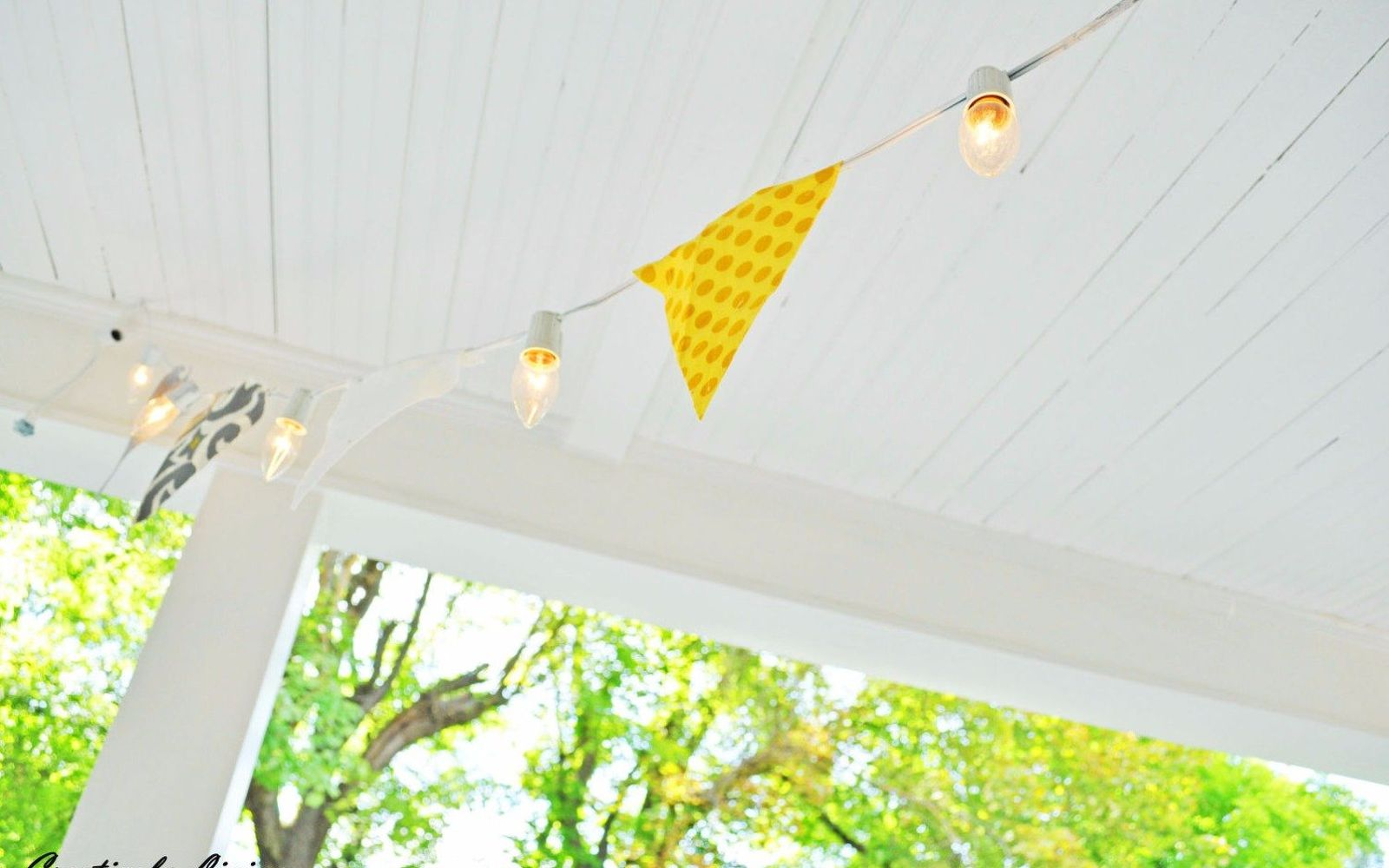 16 unexpected ways to use christmas lights this summer hometalk make a festive banner for your porch