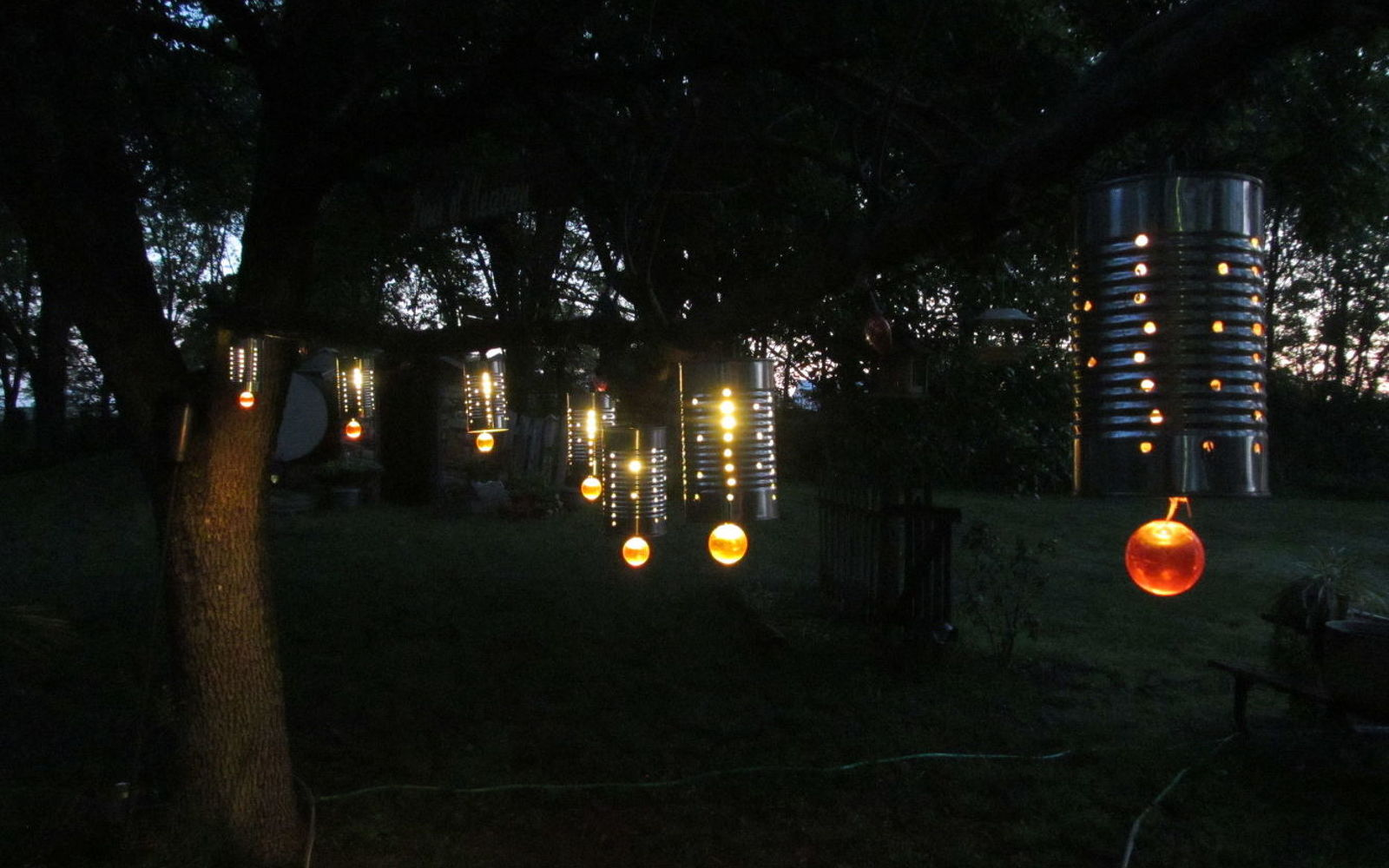 16 unexpected ways to use christmas lights this summer hometalk craft tin can lanterns for your outdoors